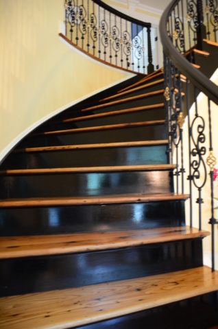 center-hallway-staircase-following-water-damage-newly-sanded-and-refinished