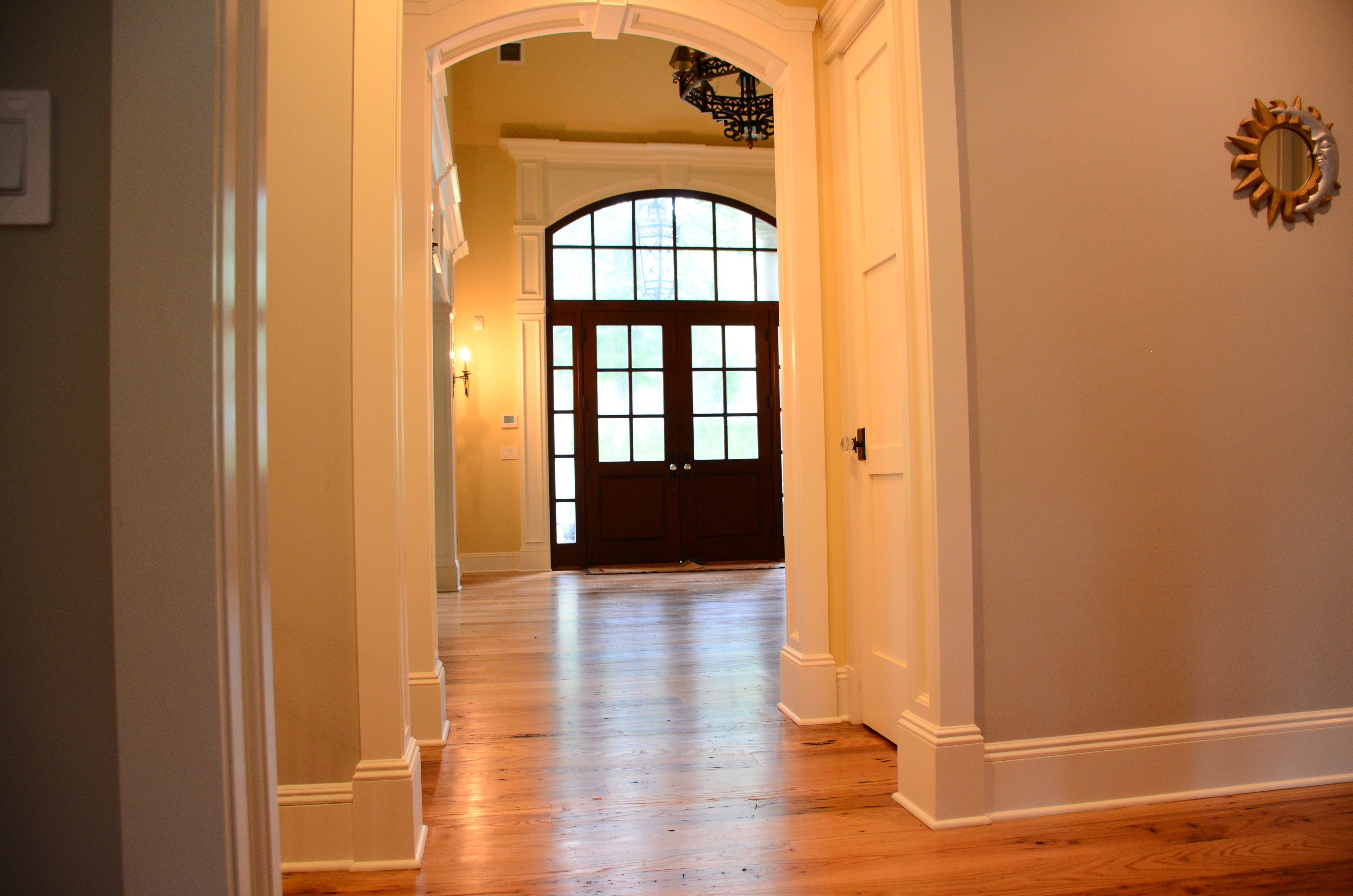 entry-hallway-view-after-freshly-installed-hand-milled-hardwood-flooring