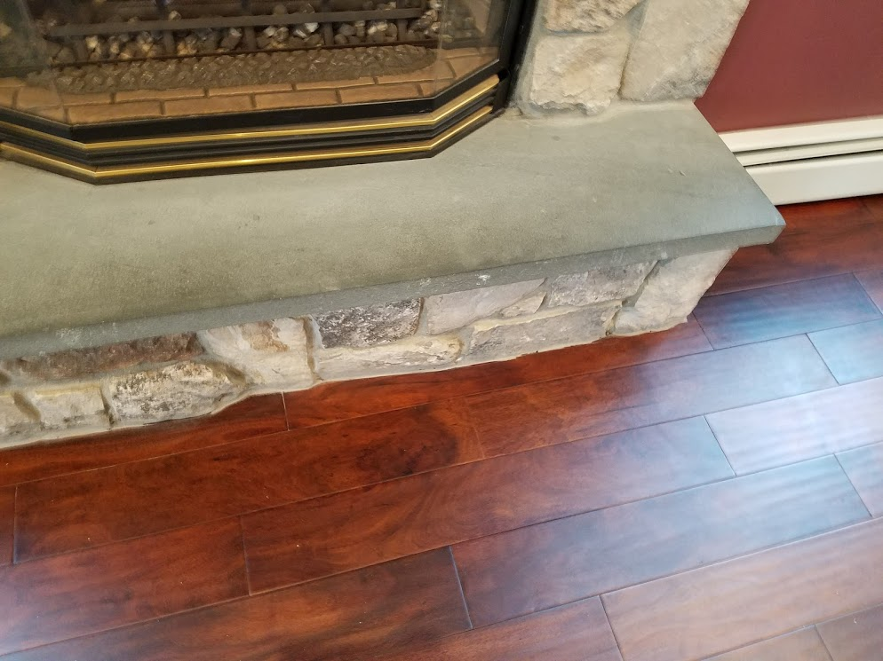 family-room-fire-place-post-new-flooring-installation-notice-how-skillfully-acacia-planks-were-scribed-in-around-the-ro