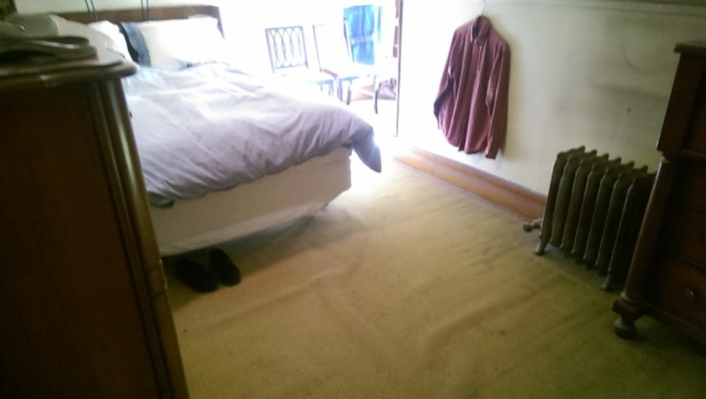 master-bedroom-with-old-worn-out-carpet