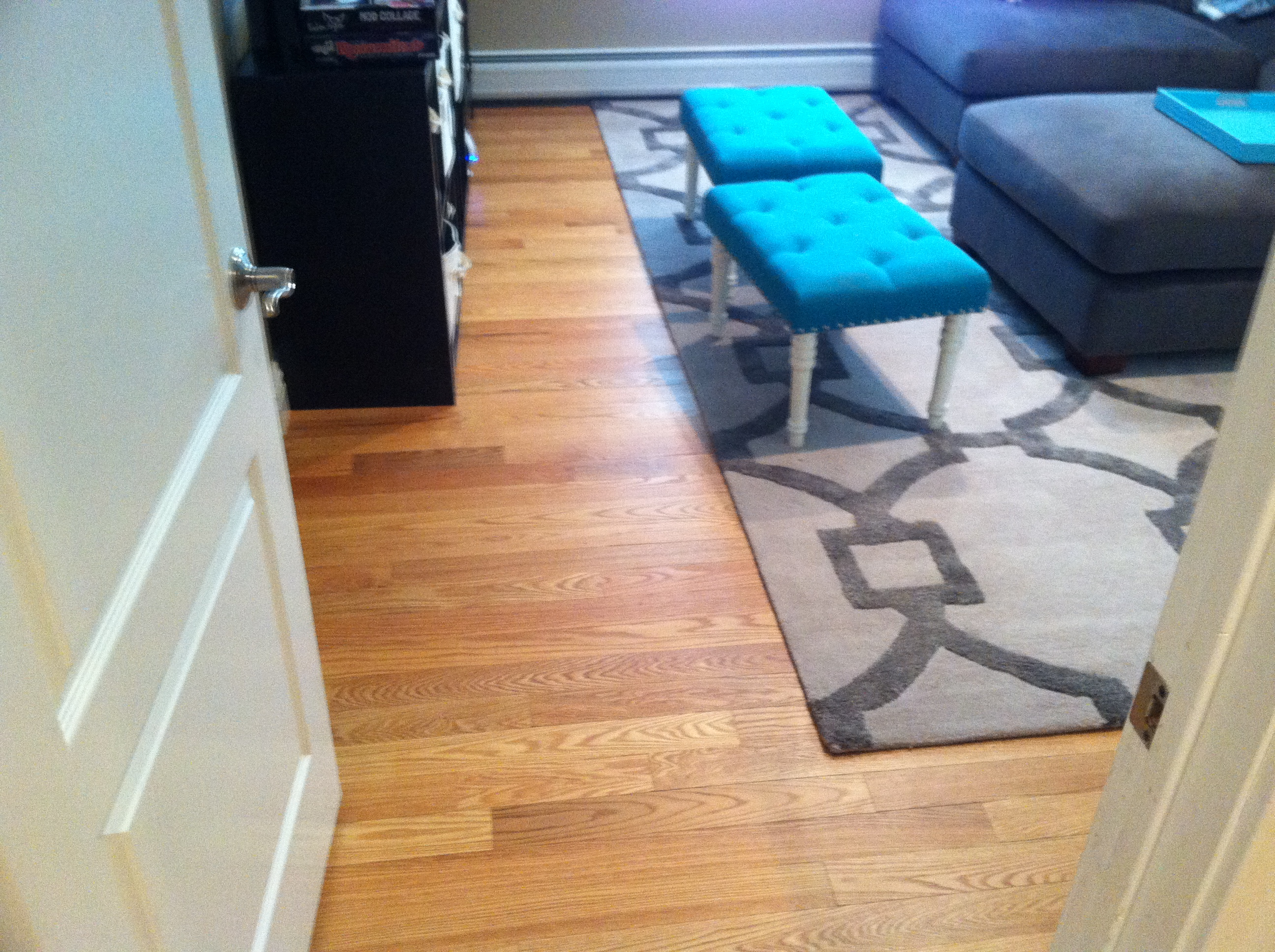 tv-and-den-area-before-dustless-sanding-and-refinishing-process