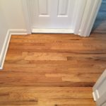 Hallway at base of stairway - following a clean and thorough dustless sanding refinishing process
