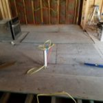 Hillsdale - Laying Sub Flooring in Kitchen prior to installation of solid hardwood