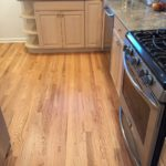 Kitchen - Unfinished Red Oak planks replace gray tiles