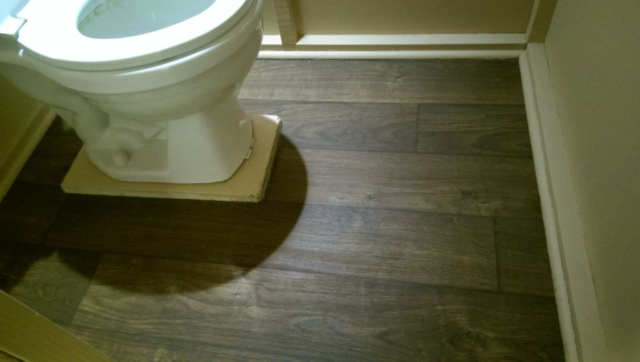 toilet-with-newly-replaced-wood-plank-vinyl-flooring