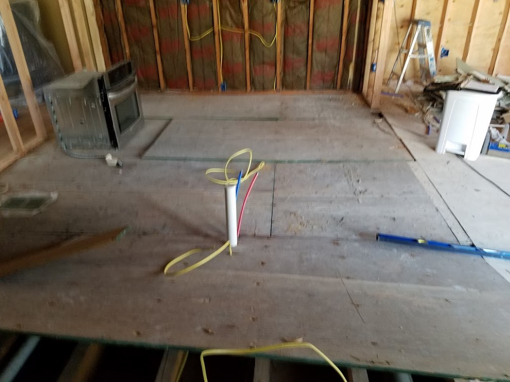 Hillsdale Laying Sub Flooring In Kitchen Prior To